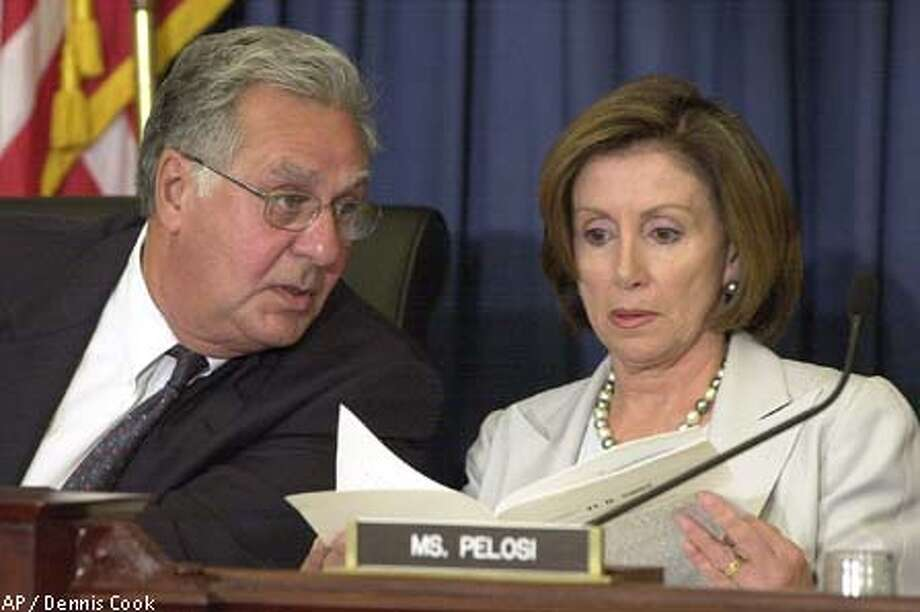 House Majority Leader Rep. Dick Armey, R-Texas, House Select Committee chair, talks with Rep. Nancy Pelosi, D-San Francisco. Associated Press photo by Dennis Cook