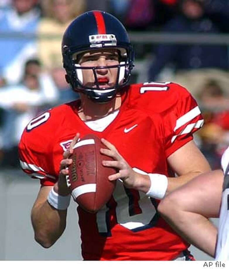 Mississippi's Eli Manning (10) looks downfield in the first half against Vanderbilt, Saturday, Dec. 1, 2001, at Vaught-Hemingway Stadium in Oxford, Miss. Manning was 23-for-40 passing with four touchdowns and three interceptions for 286 yards in Mississippi's 37-28 win. (AP Photo/Oxford Eagle, Bruce Newman) Photo: BRUCE NEWMAN