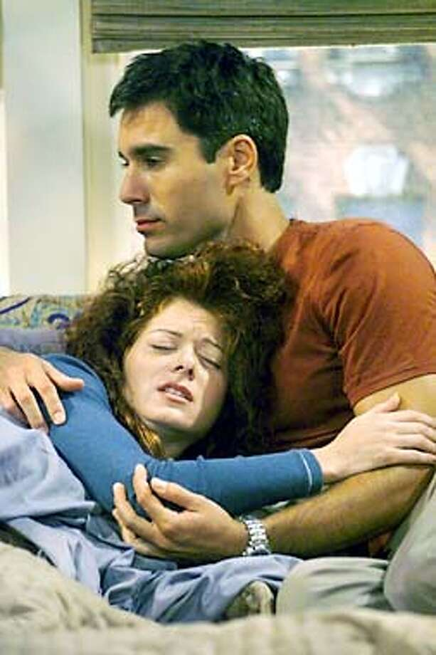 "WILL & GRACE -- NBC Series -- ""Bed, Bath and Beyond"" -- Pictured: (l-r) Debra Messing as Grace Adler, Eric McCormack as Will Truman --  NBC Photo: Chris Haston  Airdate: Thursdays on NBC (9-9:30 p.m. ET)  Posted: 10/10/01 Photo: Handout"