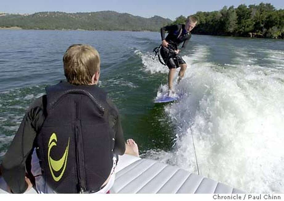wakeboard300_pc.jpg Joey Moore wakesurfed closely behind a power boat on Folsom Lake. The activity is similar to teaksurfing which Anthony Farr was doing when he died from carbon monoxide poisoning. Recreational boaters on Folsom Lake on 6/26/03 in Folsom. PAUL CHINN / The Chronicle Photo: PAUL CHINN