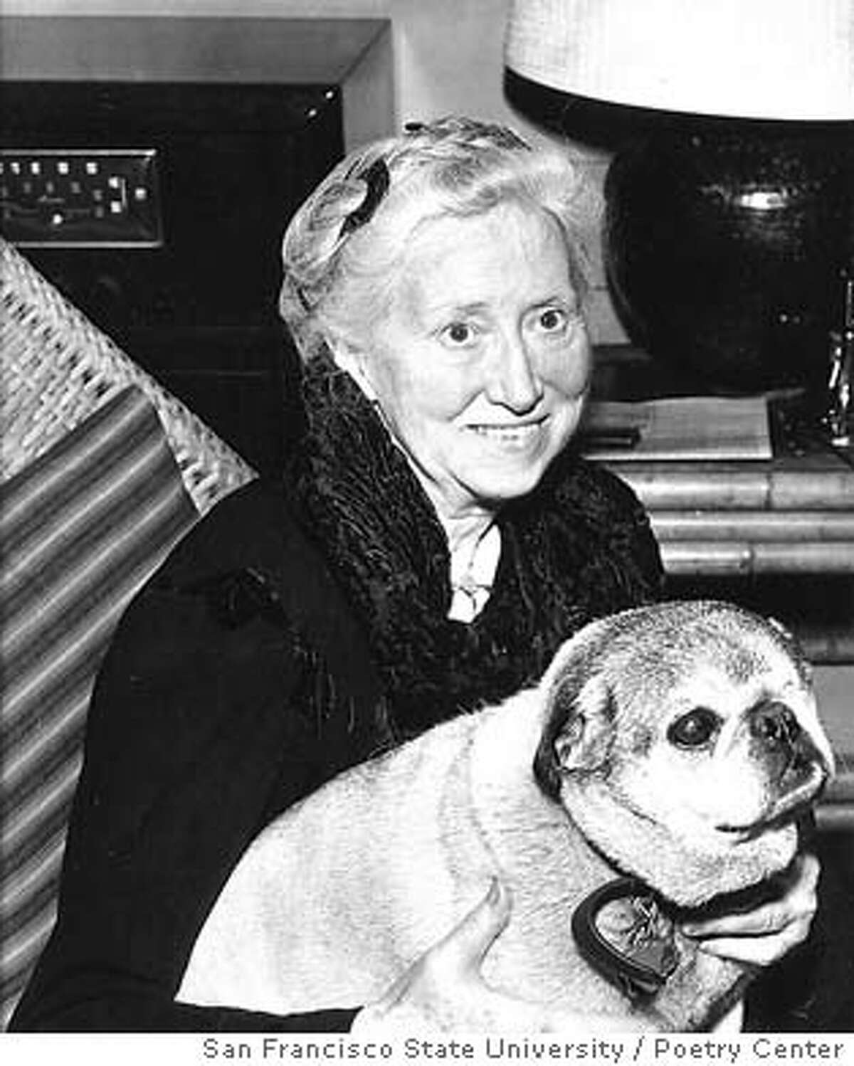 Marianne Mooer and canine, at the home of Poetry Center founding director Rith Witt-Diamant in 1957.