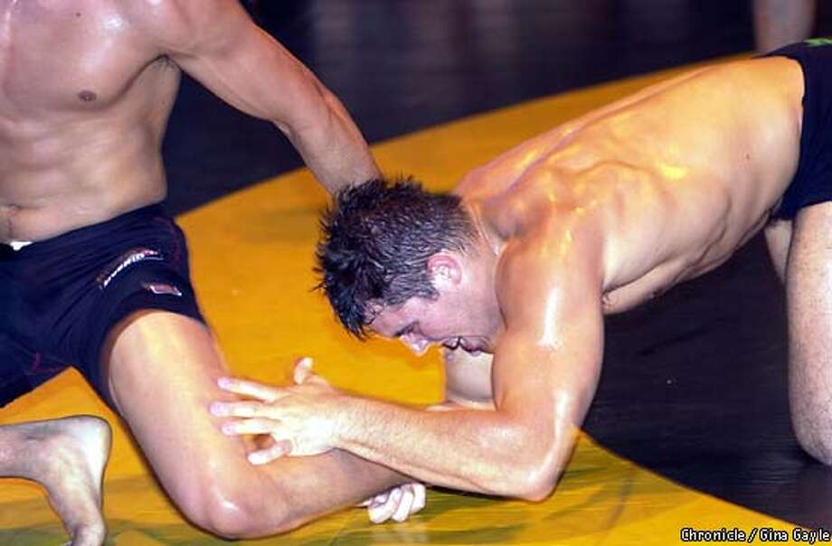 Dean Lister of San Diego grabs a hold of David Terrell of Santa Rosa during the recent Gracie Open Championships at College Park High School in Pleasant Hill. Although it may look like Dean had the upper hand but David Terrell won the match. Photo by Gina Gayle/The SF Chronicle. Photo: GINA GAYLE