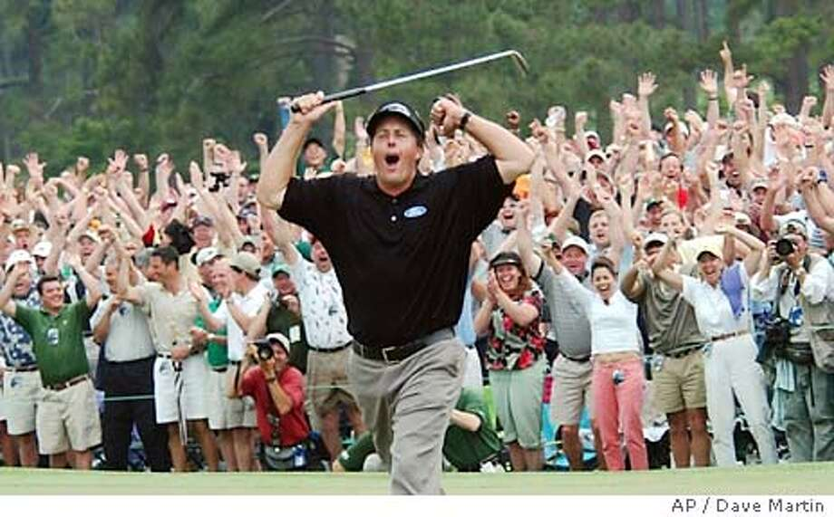Phil Mickelson celebrates after winning the golf tournament with a nine-under-par at the Augusta National Golf Club in Augusta, Ga., Sunday, April 11, 2004. (AP Photo/Dave Martin) Photo: DAVE MARTIN