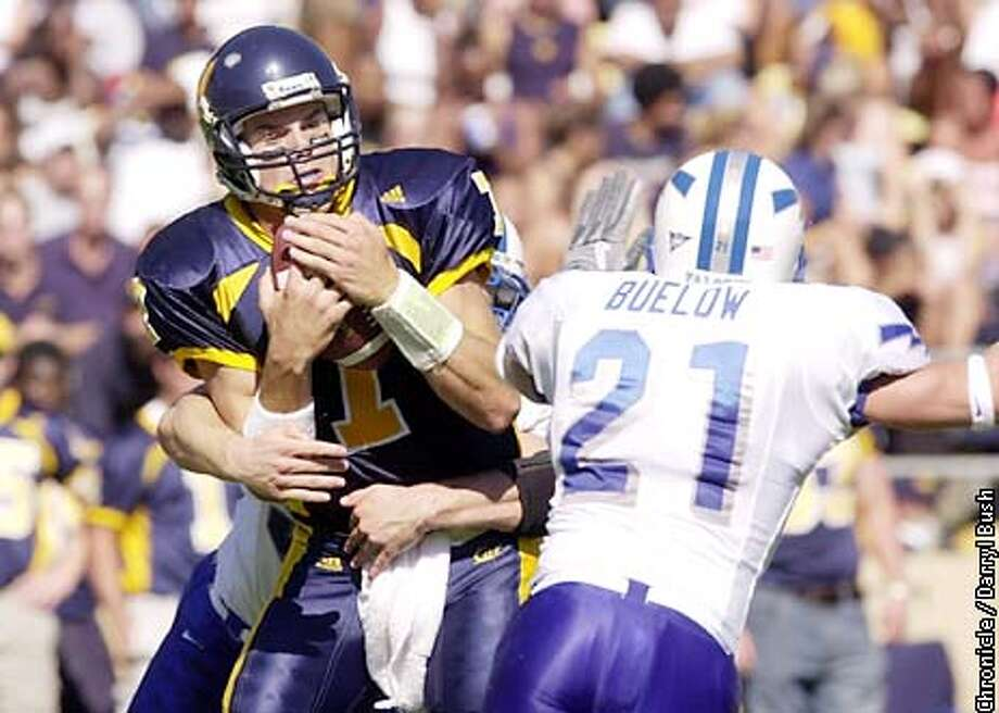 Cal's QB Kyle Boller is sacked from behind in the second qtr by Air Force at Cal. Air Force's Joel Buelow (21) is right foreg.Chronicle Photo by Darryl Bush Photo: Darryl Bush