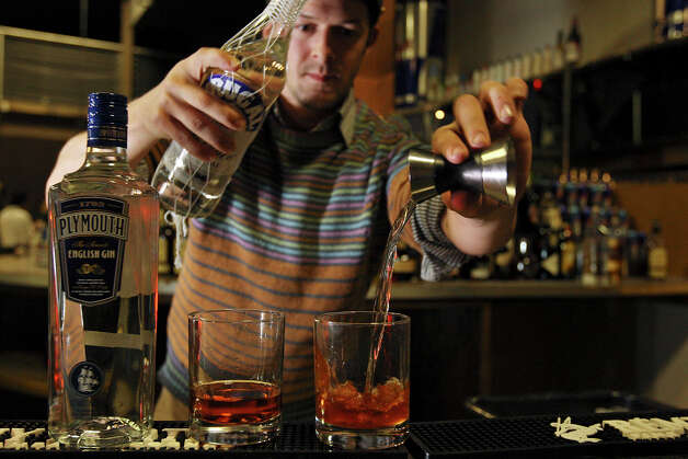 "FOR METRO - Dutch Kills Bar, in Queens, NY, bartender Zachary Gelnaw-Rubin prepares a ""Forget-Me-Not"" during the Original Cocktail Competition part of the San Antonio Cocktail Conference held Saturday Jan. 28, 2012. John Lermayer (not pictured) bartender at the Florida Room in Miami won the $2500 first prize. Photo: EDWARD A. ORNELAS, San Antonio Express-News / © SAN ANTONOI EXPRESS-NEWS (NFS)"