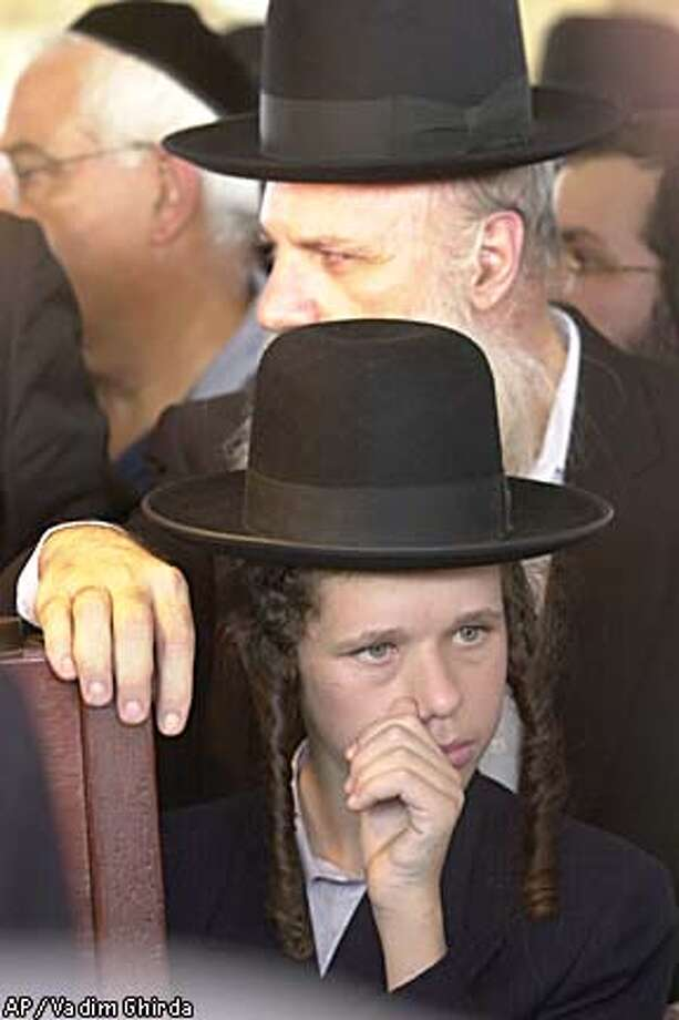 An Orthodox Jewish boy mourns at the funeral in Tel Aviv of Gal Shilon, who was killed with his 9-month-old daughter in the attack on a settlers' bus at Emmanuel settlement. Associated Press photo by Vadim Ghirda