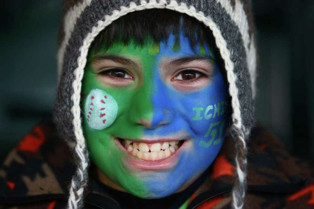 Jimmy Leota, 11, of Auburn shows his painted face during Seattle Mariners FanFest on Saturday, January 28, 2012 at Safeco Field in Seattle. The 14th Annual Mariners FanFest continues on Sunday, Jan. 28, from 11am-4pm. The event features numerous activities for children and adults alike around the concourse. FanFest also lets attendees run the bases, play catch on the field, and do a virtual sportscast.