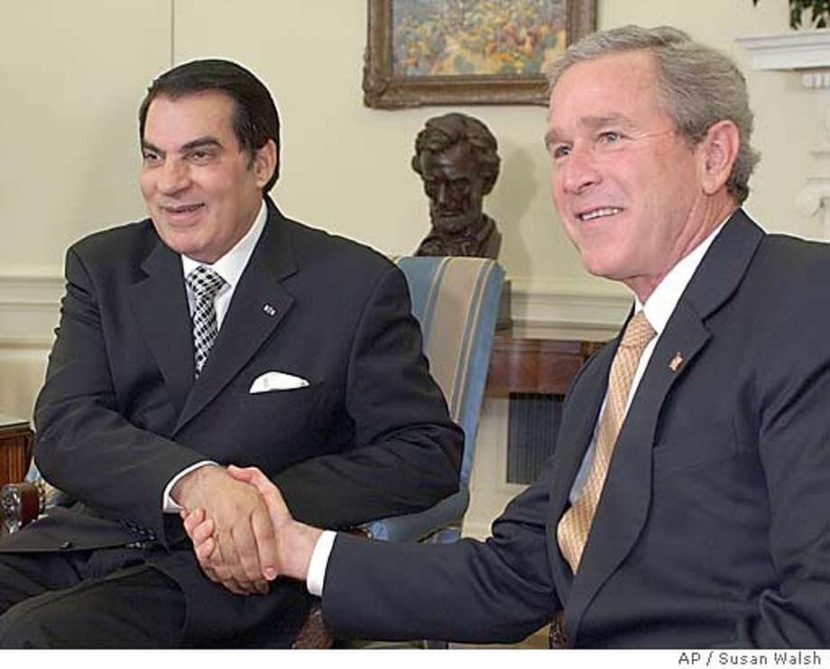 President Bush shakes hands with Tunisian President Zine El Abidine Ben Ali, a close Muslim ally in the war on terror who's being urged to liberalize his rule, in the Oval Office of the White House, Wednesday, Feb. 18, 2004. (AP Photo/Susan Walsh) Photo: SUSAN WALSH