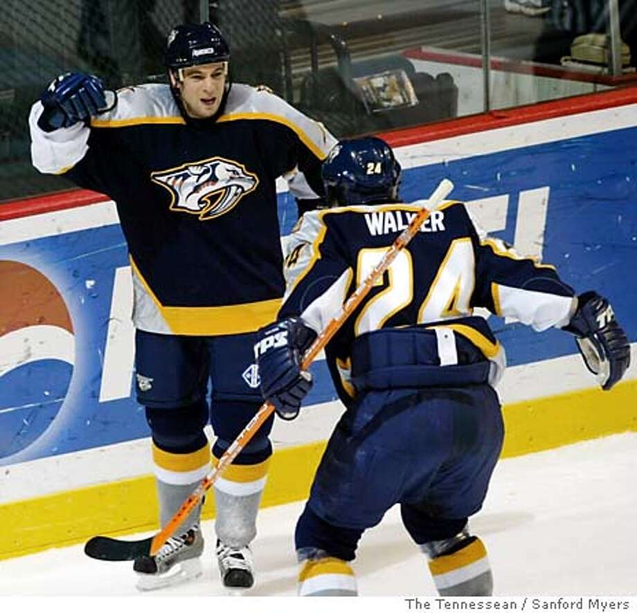 Nashville Predators wing Steve Sullivan, left, celebrates with teammate Scott Walker (24) after Sullivan scored his third goal of the game against the San Jose Sharks in the second period on Wednesday, Feb. 18, 2004, in Nashville, Tenn. Sullivan's hat trick came in his first game with the Predators, who acquired him from the Chicago Blackhawks. (AP Photo/The Tennessean / Sanford Myers) Photo: SANFORD MYERS