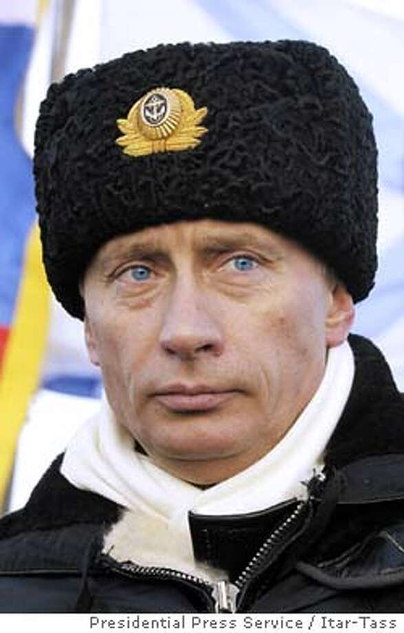 """Russian President Vladimir Putin observes from aboard the submarine """"Archangelsk"""" during exercises in the Barents sea near Severomorsk February 17, 2004. Mystery surrounded huge military exercises in Arctic Russia attended by President Putin on Tuesday with some navy sources saying a planned missile launch had failed while top brass denied anything unusual had happened. REUTERS/Presidential Press Service / Itar-Tass Photo: STR"""