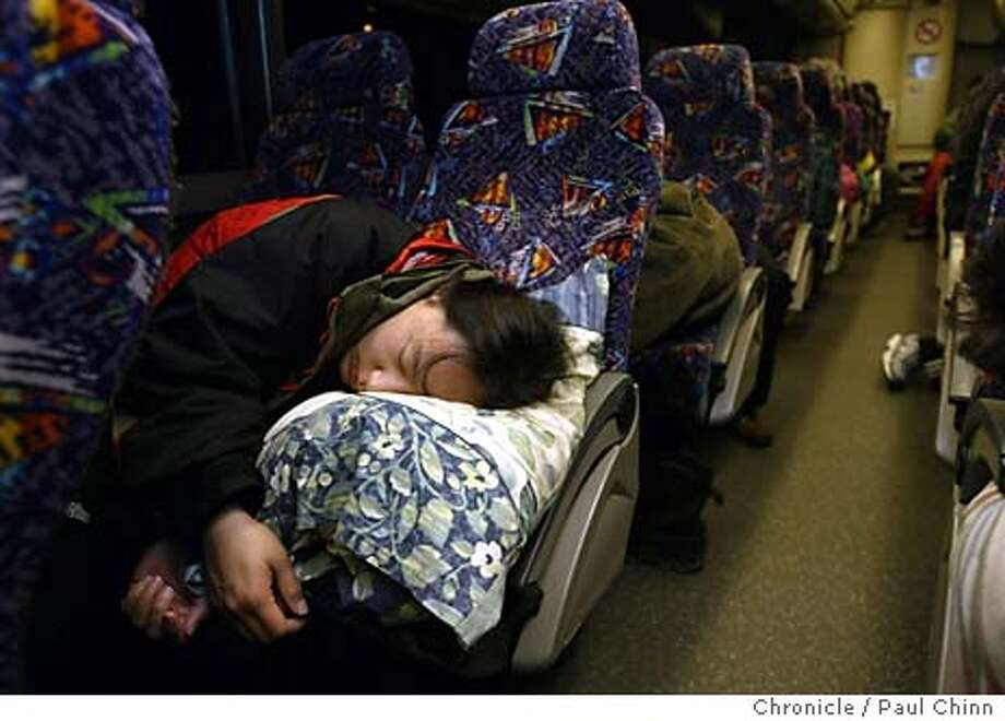 skibus19_008_pc.JPG Julie Chen, of San Jose, got a few more hours of sleep on the bus on the way to Kirkwood. Skiiers board a charter bus headed for Kirkwood on 2/12/04 in Walnut Creek. PAUL CHINN / The Chronicle ProductName	Chronicle Julie Chen of San Jose catches a few winks on her way to Kirkwood on the Bay Area Ski Bus. Photo: PAUL CHINN