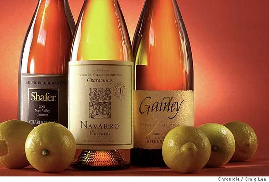 Photo for the cover of the Wine section on Chardonnays made with little or no malolactic fermentation techniques. These wines emphasize the fruit, acidity and brightness. The Chardonnay wines in the photo are Gainey 2001 Santa Rita Hills, Navarro 2001 Anderson Valley and Shafer 2001 Red Shoulder Ranch. Food styled by Amanda Berne. Event on 2/4/04 in San Francisco.  CRAIG LEE / The Chronicle Photo: CRAIG LEE