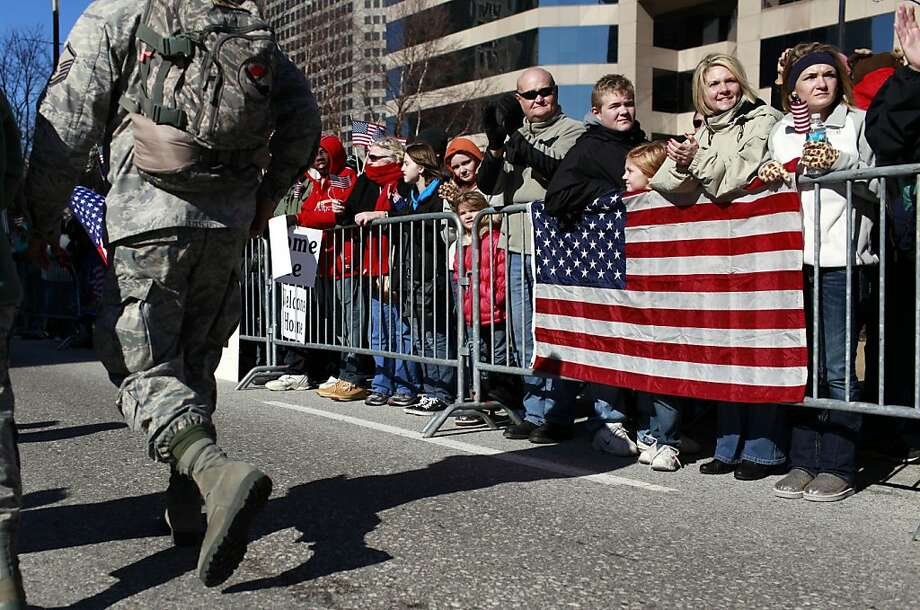 Spectators applaud as a parade to honor Iraq War veterans passes Saturday, Jan. 28, 2012, in St. Louis. Thousands turned out to watch the first big welcome home parade in the U.S. since the last troops left Iraq in December. (AP Photo/Jeff Roberson) Photo: Jeff Roberson, Associated Press