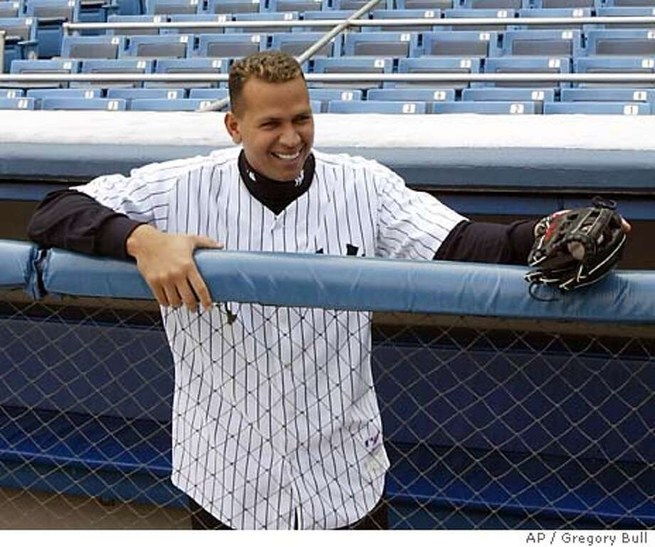 Alex Rodriguez surveys Yankee Stadium wearing his new number 13 jersey at Yankee Stadium in New York Tuesday, Feb. 17, 2004.(AP Photo/Gregory Bull) Photo: Gregory Bull