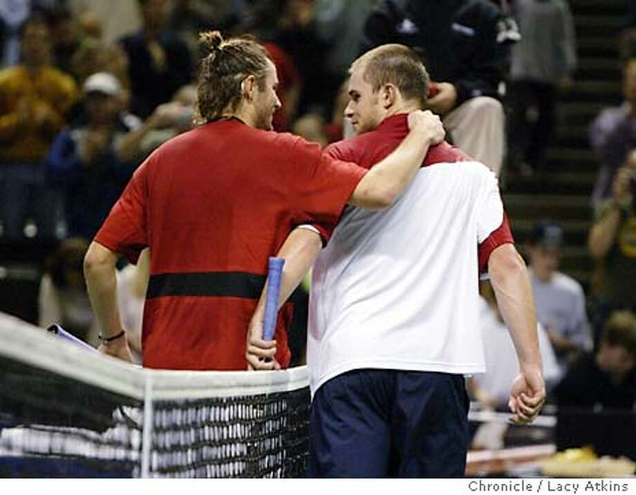 Mardy Fish congratulates Andy Roddick at the end of the match in the finals of the Siebel Open Tennis match, Sunday Feb.15, 2004, in San Jose.Roddick defeats Fish, (7-6) (6-4) Photo By Lacy Atkins Photo: LACY ATKINS