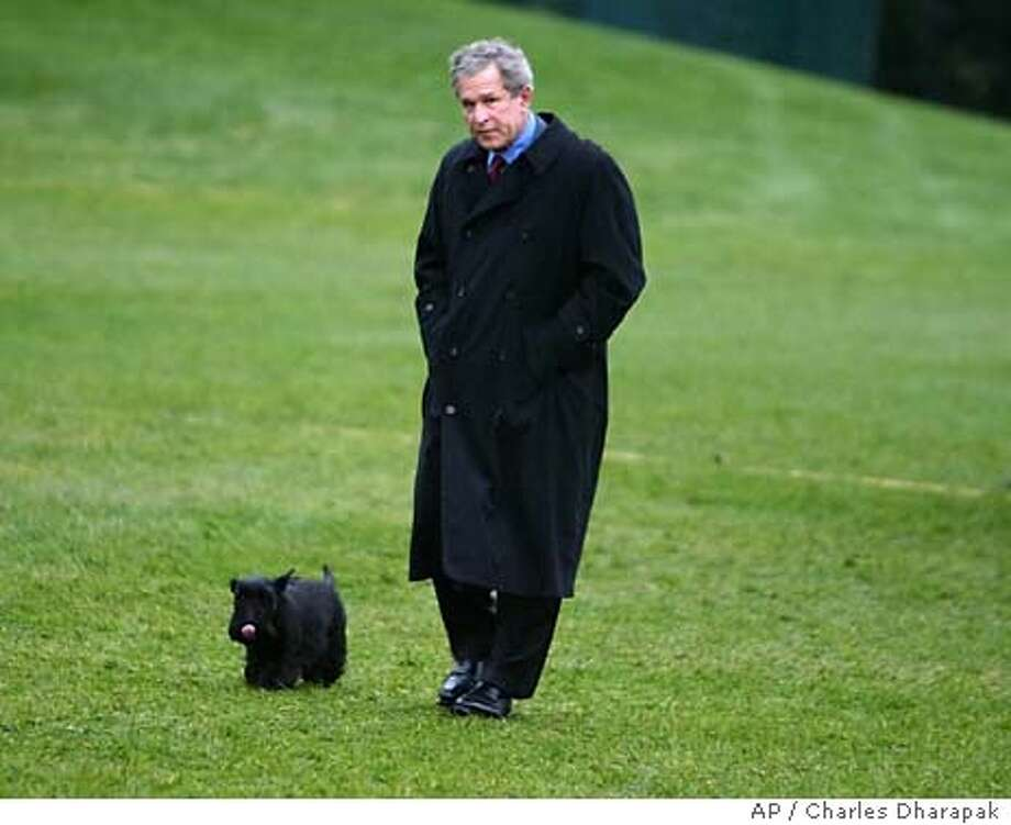 President Bush walks with his dog Barney after returning from spending the Easter holiday at his Texas ranch on the South Lawn of the White House Monday, April 12, 2004 in Washington. Bush met with Egypt's President Hosni Mubarak earlier in the day. (AP Photo/Charles Dharapak) Photo: CHARLES DHARAPAK