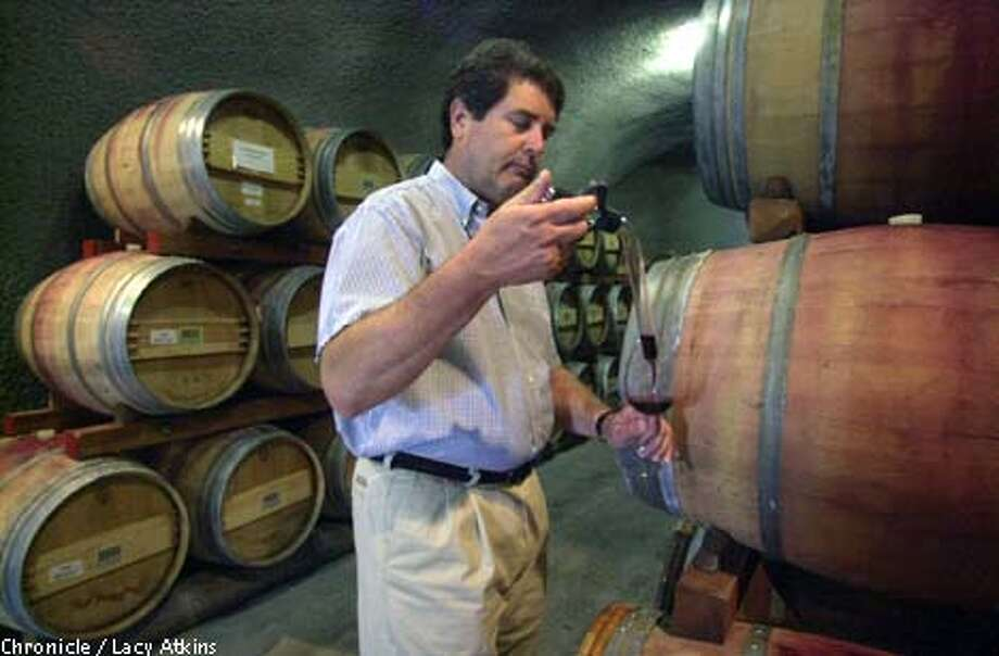 Flora Springs: Winemaker Ken Deis samples from a barrel using a wine thief. Chronicle photo by Lacy Atkins