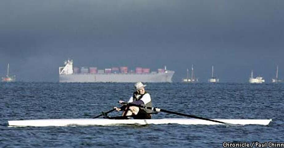 A loaded freighter was heading for the Pacific Ocean behind rower Joe Spitzley. Members of the Open Water Rowing Club took to the water of Richardson Bay. PAUL CHINN/S.F. CHRONICLE Photo: PAUL CHINN