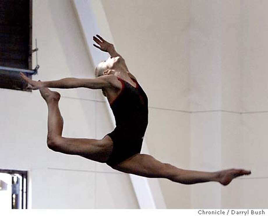 Lindsay Wing of Stanford women's gymnastics team goes high in the air while practicing on balance beam at Burnham Pavilion.  Event on 4/9/04 in Stanford.  Darryl Bush / The Chronicle Photo: Darryl Bush