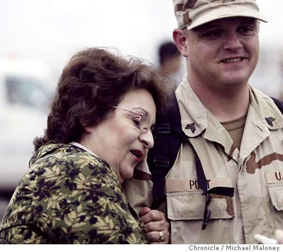 GUARD12_070_MJM.jpg  Meredith Post of Newark holds on to her son Sgt Arthur Post.  About 90 National Guard soldiers who have spent the past year in Karbala and other areas in Iraq return home at Oakland International Airport early Easter morning. Photo by Michael Maloney / CHRONICLE Photo: Michael Maloney