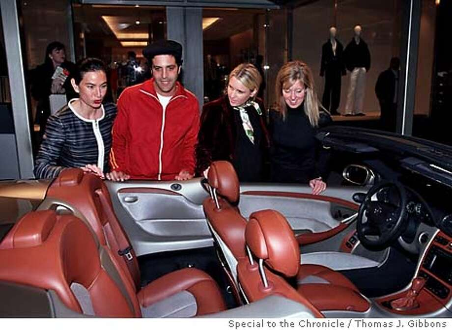 social18_021204_ho  Unveiling of new Mercedes outside Armani boutique. From left to right: Look, but don't touch:�Yuki�Vandenende, Sam Green, Megan Carlson, and Lisa Holladay admire a new Mercedes with interior by Giorgio Armani, not available to the public.  Special to the Chronicle/ Thomas J. Gibbons.  � Car and fashion admirers inspect a new Mercedes CLK convertible, fitted with an Armani leather interior, being unveiled outside of the Armani boutique on Post Street. Photo: Thomas J. Gibbons