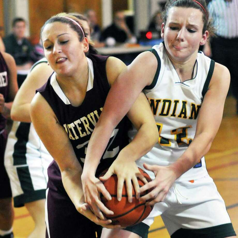 Watervliet's #32 Victoria Shufelt,left, and Ravena's #22 Kayla Hotaling during Saturday's game at Voorheesville high Jan. 28, 2012.  (John Carl D'Annibale / Times Union) Photo: John Carl D'Annibale / 00016237A