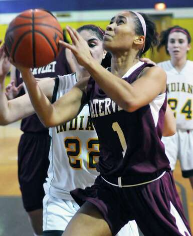 Watervliet's #1 Ailayla Demand drives through Ravena defenders during Saturday's game at Voorheesville high Jan. 28, 2012.  (John Carl D'Annibale / Times Union) Photo: John Carl D'Annibale / 00016237A
