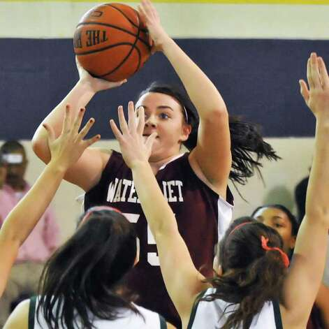 Watervliet's #55 Mikayla DeGuire, goes to the basket against Ravena defenders during Saturday's game at Voorheesville high Jan. 28, 2012.  (John Carl D'Annibale / Times Union) Photo: John Carl D'Annibale / 00016237A