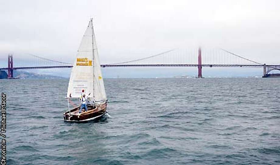 """63 year old Ken-ichi Horie sails his 19 foot sailboat, """"Malt's Mermaid III"""" into SF Bay after his voyage from Japan. His journey started May 19th and is a duplicate voyage he took back in 1962. by Michael Macor/The Chronicle Photo: MICHAEL MACOR"""