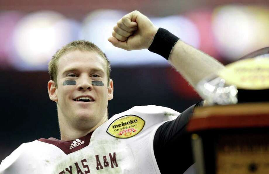 Texas A&M quarterback Ryan Tannehill (17) raises a fist after being named the Most Valuable Player after the Car Care Bowl NCAA college football game against Northwestern Saturday, Dec. 31, 2011, in Houston. Texas A&M defeated Northwestern 33-22. Photo: AP