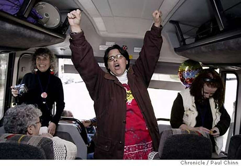 caravan_029_pc.JPG Marta Donayre, who did not make the trip, climbed aboard the bus to rally the troops before they departed on Saturday. Same-sex marriage supporters embark on an overnight bus trip to Redding to drum up support on 2/14/04 in Sacramento. PAUL CHINN / The Chronicle Photo: PAUL CHINN