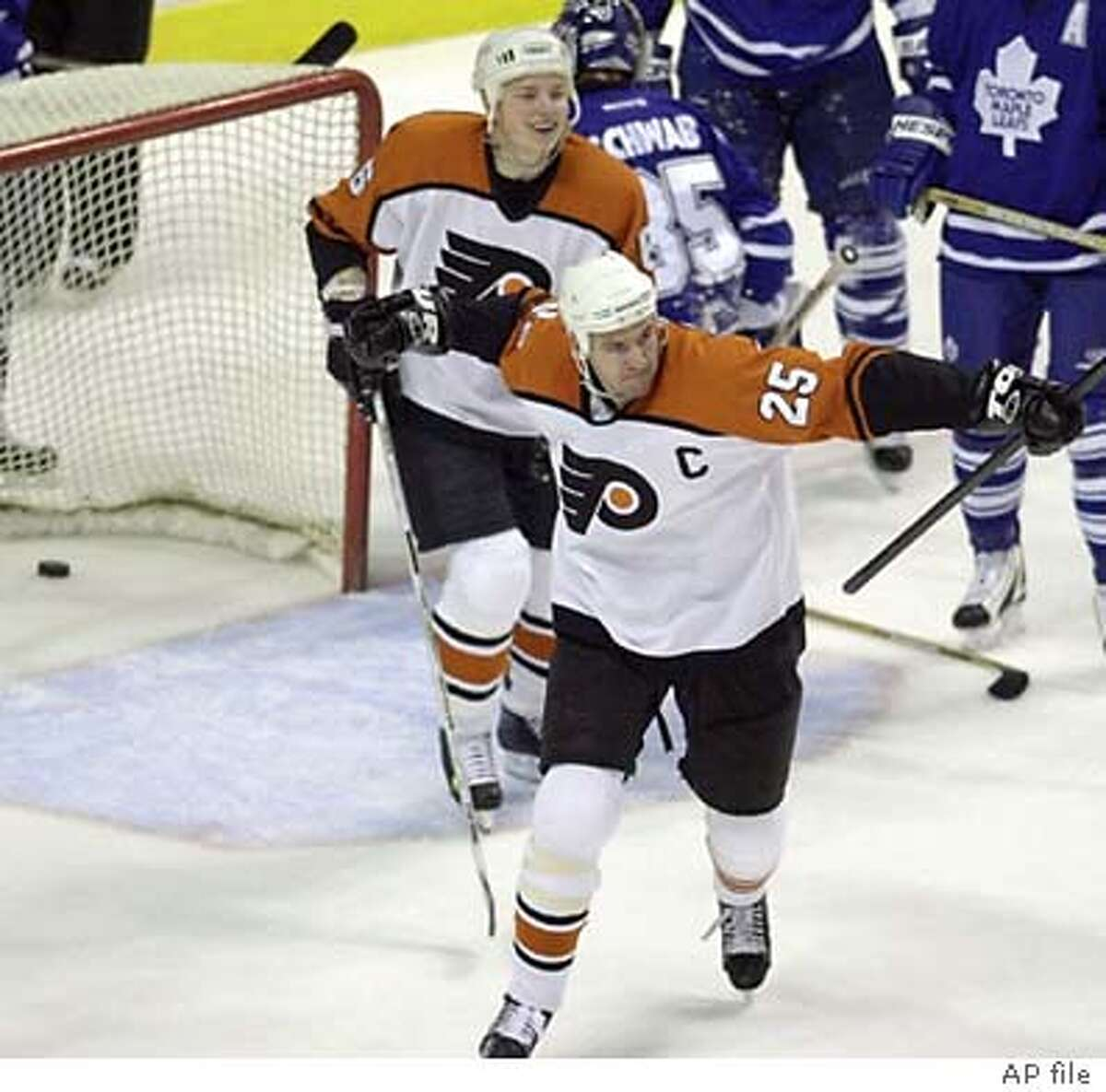 Philadelphia Flyers' Keith Primeau, right, reacts with teammate Ruslan Fedotenko, left, of Ukraine, after Primeau scored his second goal of the night against the Toronto Maple Leafs in the second period Monday, March 25, 2002, in Philadlephia. (AP Photo/Chris Gardner)