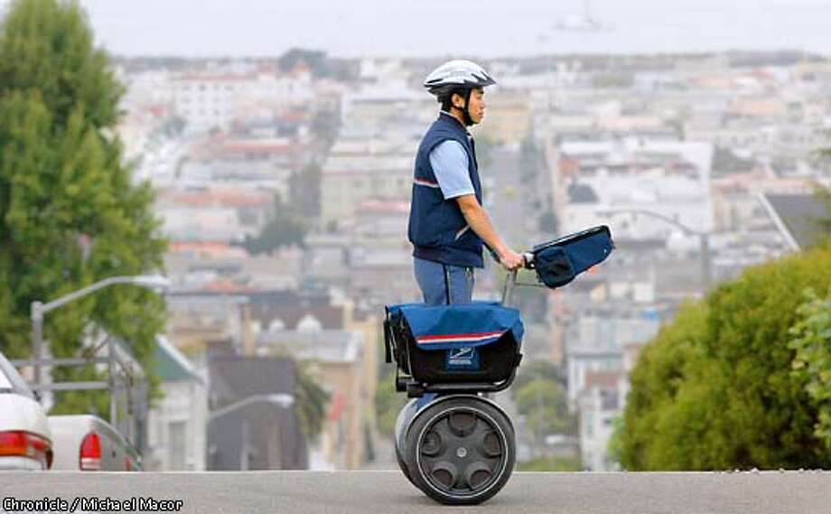 The US postal service to begin testing the fesability of the delivery of mail using the Segway Human Transporter. Letter carrier K Ng uses the scooter as he makes his rounds down Jackson St. in San Francisco. Testing will be conducted for approximatley eight weeks. by Michael Macor/The Chronicle Photo: MICHAEL MACOR