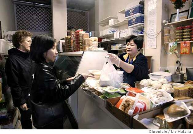 Hang Nguyen (right) makes about 400 sandwiches on a regular day at Saigon Sandwiches.A two block area around Larkin St. has recently been designated as Little Saigon. Shot on 2/3/04 in San Francisco. LIZ HAFALIA / The Chronicle Photo: LIZ HAFALIA