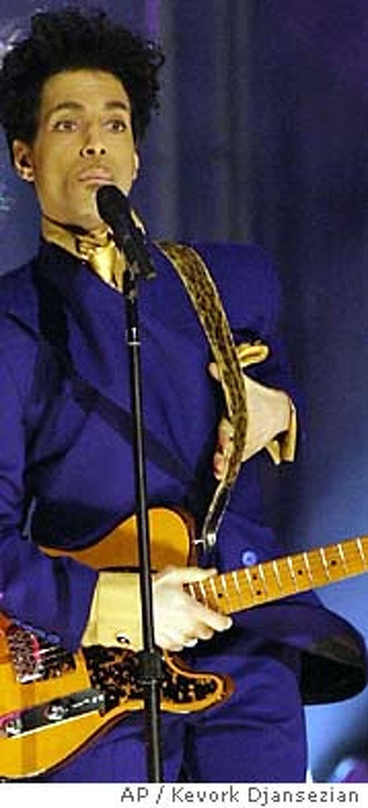 Beyonce, left, and Prince perform during the 46th Annual Grammy Awards, Sunday, Feb. 8, 2004, in Los Angeles. (AP Photo/Kevork Djansezian)