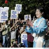 rally_196_pc.JPG Comedian Margaret Cho fired up the crowd with a humorous touch during the rally. Supporters of same-sex marriages held a rally in front of the State Capitol on 2/14/04 in Sacramento. PAUL CHINN / The Chronicle