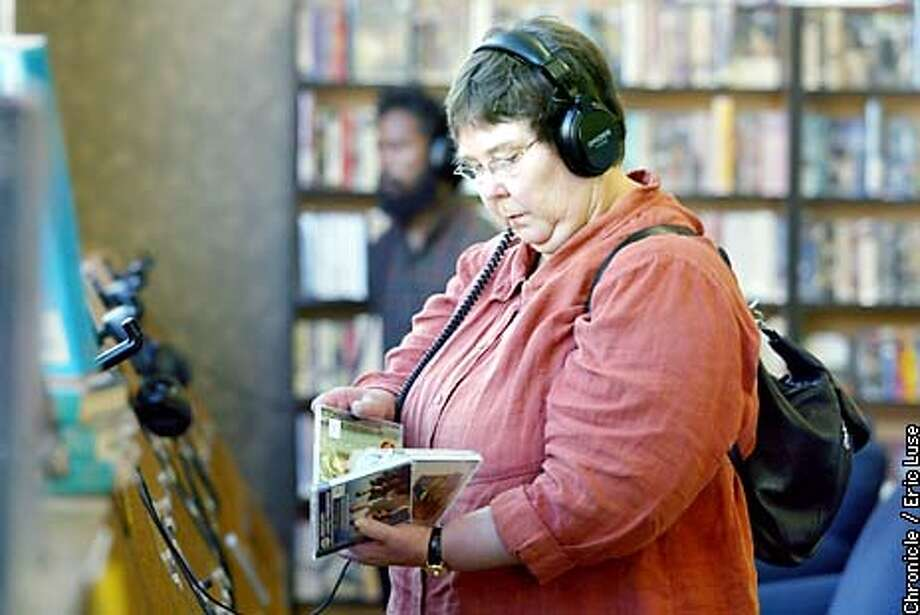 Customer Ramona Davies, listens to samples of classical music at SF Tower Music in the annex store in San Francisco. BY ERIC LUSE/THE CHRONICLE Photo: ERIC LUSE