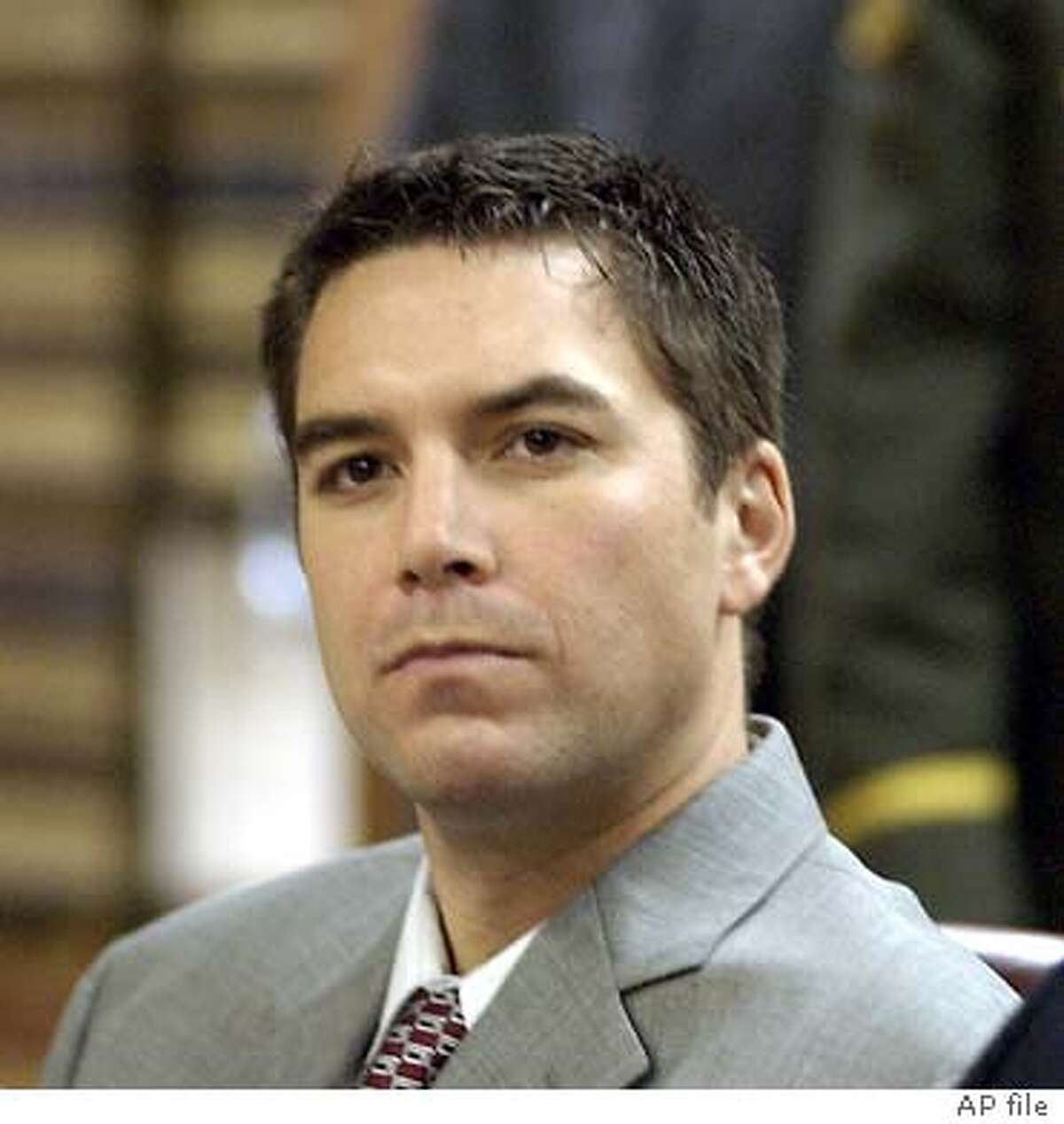 Scott Peterson is shown in a courtroom in Modesto, Calif., Tuesday, Jan. 20, 2004, during a change-of-venue hearing in his trial. The judge in the murder case against Scott Peterson moved the trial about 90 miles away to the San Francisco Bay area Tuesday because of hostility toward Peterson in his dead wife's hometown. (AP Photo/Al Golub, Pool) Scott Peterson will be tried in San Mateo County for the slaying of his wife and unborn son.
