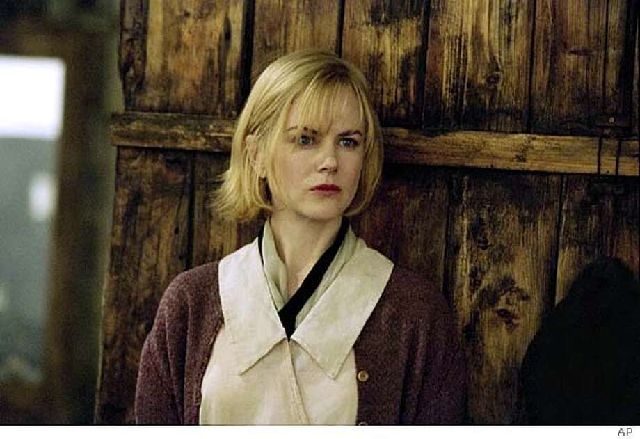 "Grace (Nicole Kidman) is on the run, who ends up in a small mountain town in Lions Gates' film ""Dogville"" (AP Photo/Lions Gate Films) Nicole Kidman plays Grace in Lars von Trier's &quo;Dogville.&quo;"