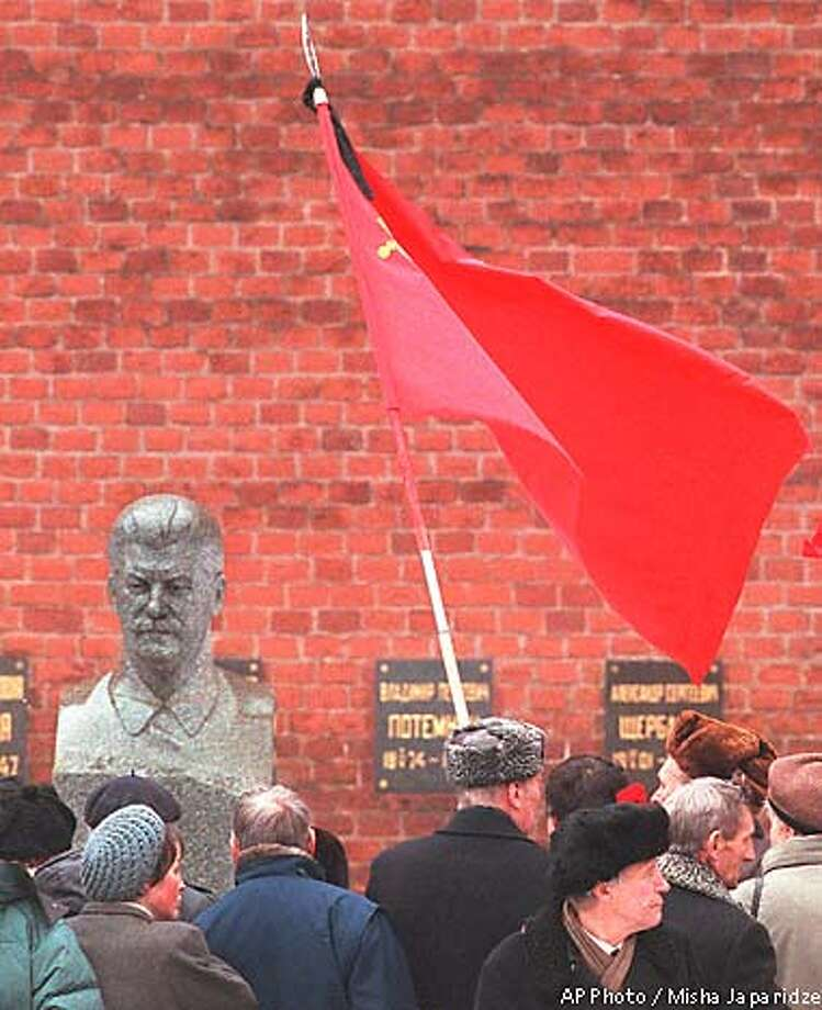 Communist hard-liners mark the anniversary of Stalin's death by visiting his grave in Moscow's Red Square. Associated Press photo by Misha Japaridze