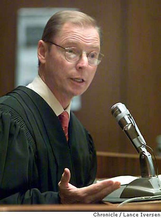 Superior Court Judge James Warren addresses the jury prior to its delivery of the verdicts in the San Francisco dog mauling trial in a courtroom in Los Angeles, Thursday, March 21, 2002. Two San Francisco attorneys, Marjorie Knoller and Robert Noel, were convicted on all five counts including a second-degree murder charge against Knoller, in the death of 33-year-old Diane Whipple. (AP Photo/Lance Iversen, Pool) ALSO RAN 04/10/02, 9/16/02 Photo: LANCE IVERSEN