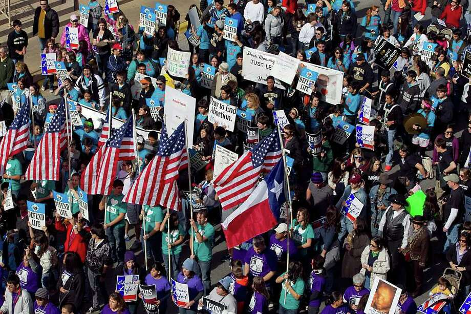 Participants march through downtown Austin during the 2012 Texas Rally for Life, an anti-abortion rally held at the Capitol in Austin, Texas, on Saturday, January 28, 2012. Photo: RODOLFO GONZALEZ, AUSTIN AMERICAN-STATESMAN / AUSTIN AMERICAN-STATESMAN