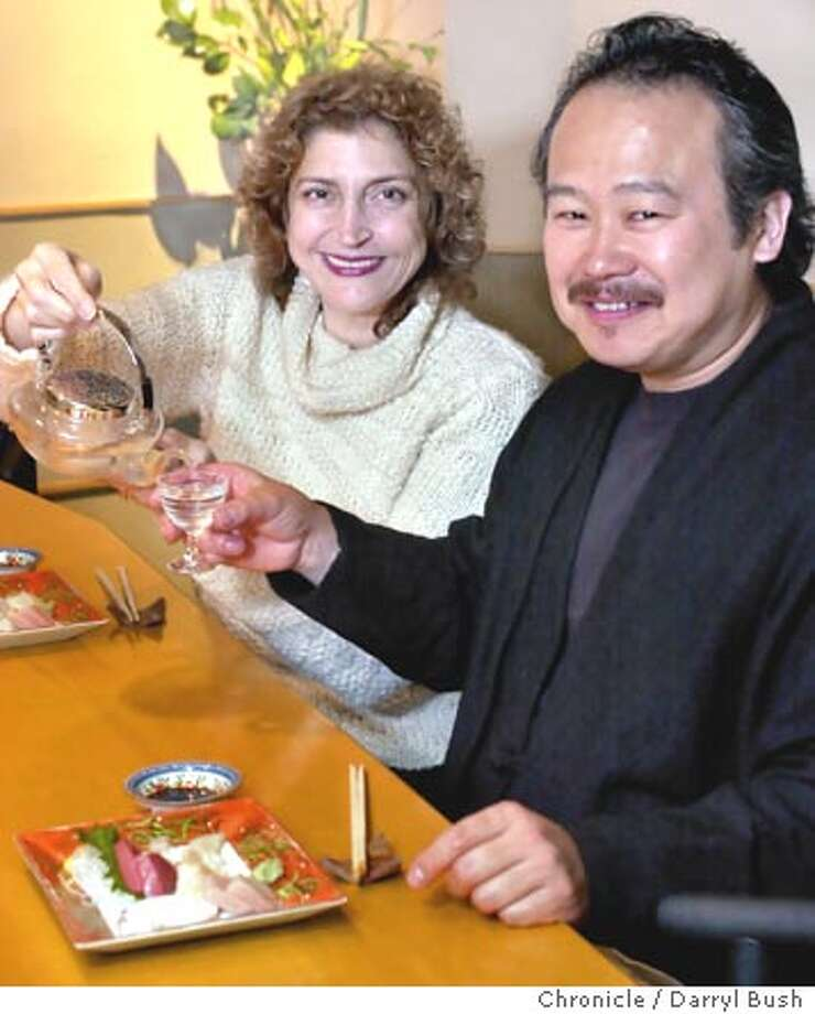 Terra restaurant of St. Helena chefs, Hiro Sone and Lissa Doumani visit Nishiki restaurant. Proprietor Rumiko Kimura pours tea. 1/27/04 in San Francisco. DARRYL BUSH / The Chronicle Photo: DARRYL BUSH