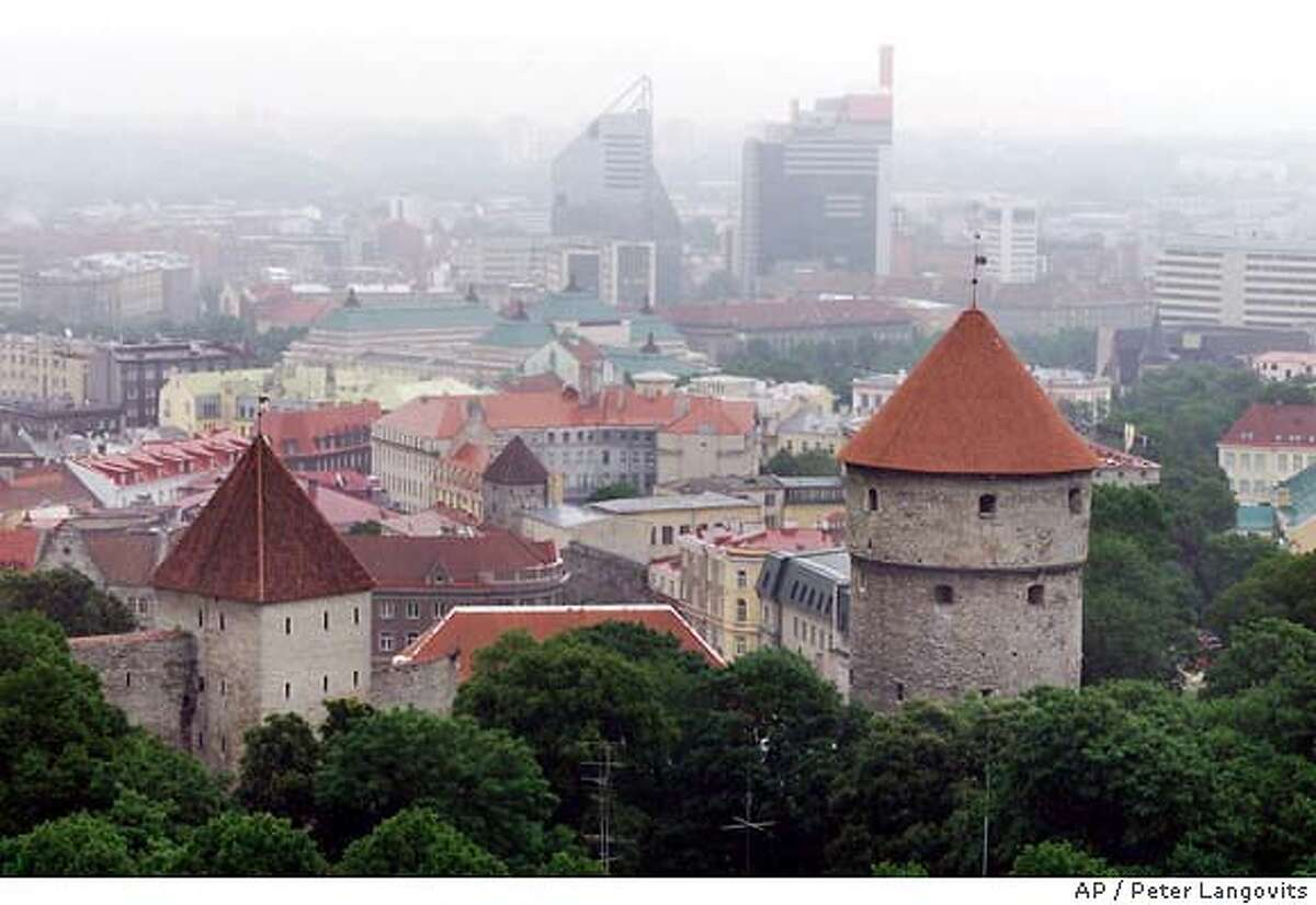 The Old City in the Estonian capital of Tallinn, with more modern buildings in the background, is shown April 24, 2001. Since the collapse of the Soviet Union, while many of the other 12 former Soviet states have floundered and have even elected former communists back into office, the Baltics have faced resolutely to the West and have brought an impossible dream within reach: the prospect of membership in NATO and the prosperous, borderless European Union. (AP Photo/Peter Langovits) The Old City in Tallinn, capital of Estonia, edges up to more modern buildings in the background.