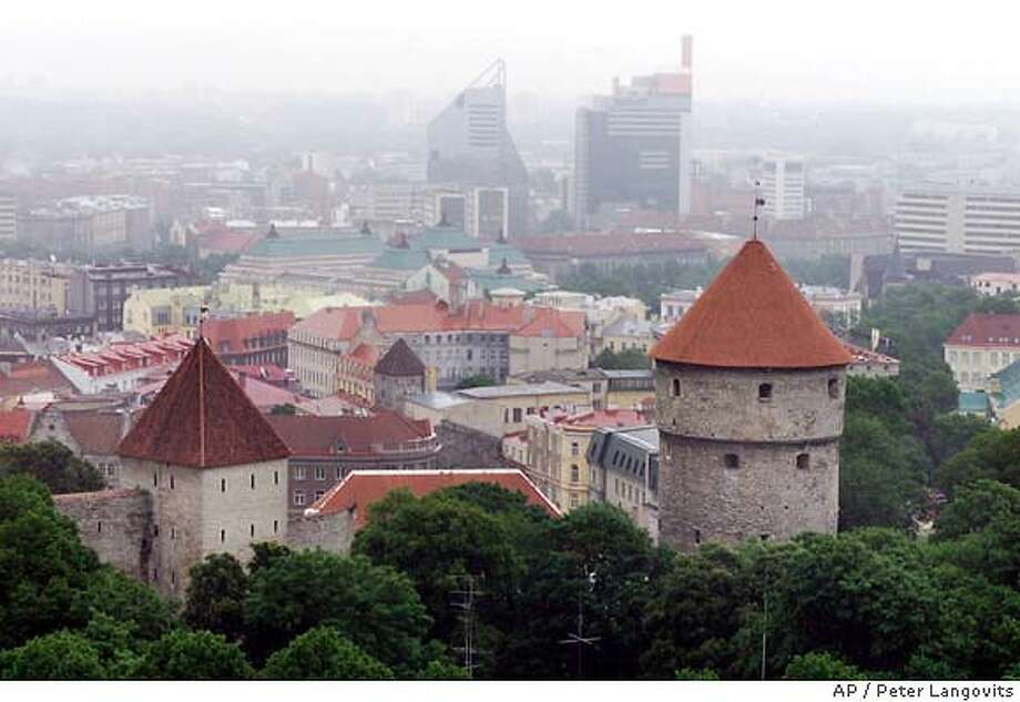 The Old City in the Estonian capital of Tallinn, with more modern buildings in the background, is shown April 24, 2001. Since the collapse of the Soviet Union, while many of the other 12 former Soviet states have floundered and have even elected former communists back into office, the Baltics have faced resolutely to the West and have brought an impossible dream within reach: the prospect of membership in NATO and the prosperous, borderless European Union. (AP Photo/Peter Langovits) The Old City in Tallinn, capital of Estonia, edges up to more modern buildings in the background. Photo: PEETER LANGOVITS