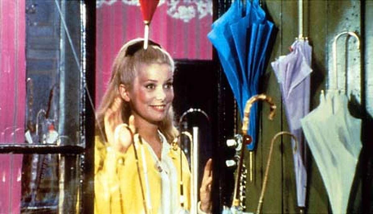 "Catherine Deneuve in the movie ""Umbrellas of Cherbourg."""
