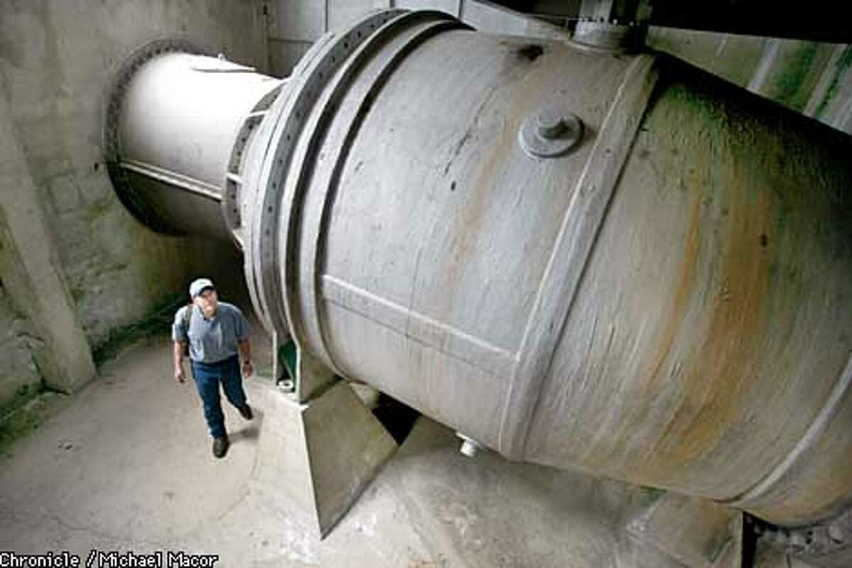 Watershed Keeper Mike Fong,walks under one of the needle valves used to release water from the dam. Valves built in 1934 coild use new seals inside. The Hetch Hetchy Dam in the Yosemite Valley, receives the bulk of it's water from the sierra snow pack miles above the reservoir. Wapama Falls spills into the basin. City of San Francisco, Hetch Hetchy Water system that supplies the entire city. by Michael Macor/The Chronicle