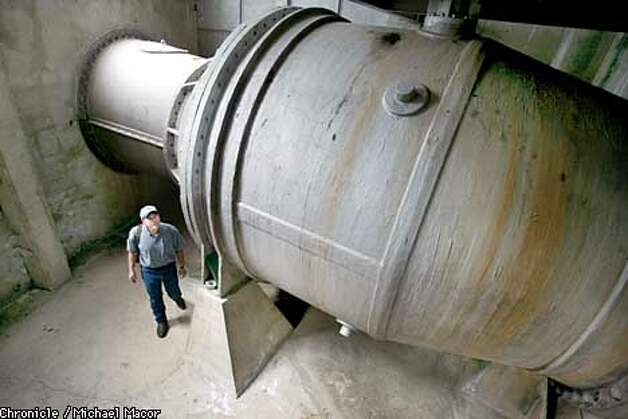 Watershed Keeper Mike Fong,walks under one of the needle valves used to release water from the dam. Valves built in 1934 coild use new seals inside. The Hetch Hetchy Dam in the Yosemite Valley, receives the bulk of it's water from the sierra snow pack miles above the reservoir. Wapama Falls spills into the basin. City of San Francisco, Hetch Hetchy Water system that supplies the entire city. by Michael Macor/The Chronicle Photo: MICHAEL MACOR