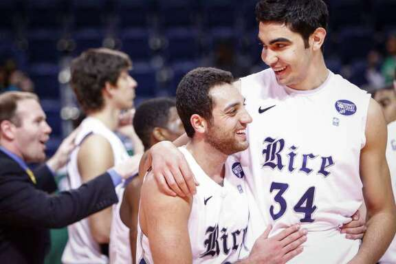Rice forward Ahmad Ibrahim (0) gives a hug to Rice center Omar Oraby (34) at the end of the Rice vs. Tulane NCAA basketball game at Tudor Fieldhouse, Saturday, Jan. 28, 2012, in Houston. Rice won the game 88-74.
