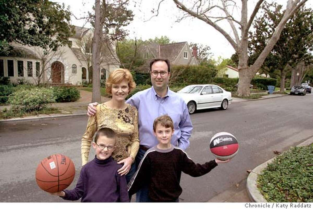Real Estate story about school performance driving up home prices. SHOWN: Sylvia and David Lichtenger (this is the correct spelling!) and their two sons, Will, 9 and a half, and Wyatt, 7 and a half (wears glasses). They're shown in front of their house with some of the very posh Palo Alto neighborhood. Shoot date is 2/1/04; writer is Marsha Ginsburg. Katy Raddatz / The Chronicle